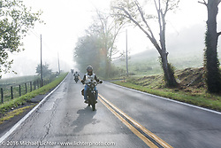 Justin Rinker of Illinois riding his 1916 Indian at the head of a pack of 100-year old bikes during the Justin Rinker of Illinois riding through the fog on his 1916 Indian during the Motorcycle Cannonball Race of the Century. Stage-3 from Morgantown, WV to Chillicothe, OH. USA. Monday September 12, 2016. Photography ©2016 Michael Lichter.
