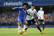Willian of Chelsea shields the ball from Muhamed Bezic of Everton. Barclays Premier league match, Chelsea v Everton at Stamford Bridge in London on Saturday 16th January 2016.<br /> pic by John Patrick Fletcher, Andrew Orchard sports photography.