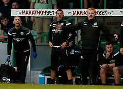 Hibernian's manager, Neil Lennon (right) back on the bench after completing a ban, looks on against Molde during the UEFA Europa League third qualifying round, first leg match at Easter Road, Edinburgh.