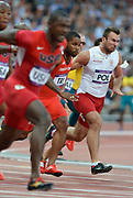 Olympic Stadium, Stratford, London, United Kingdom<br /> <br /> Description:<br /> <br /> 2012 London Olympic, Athletics, Men's 4 x 100m Relay heat<br /> . <br /> <br /> 21:30:35  Friday  10/08/2012 [Mandatory Credit: Peter Spurrier/Intersport Images]