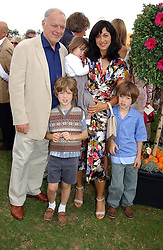 Musician DAVE GILMOUR, his wife writer POLLY SAMPSON and their children at the Veuve Clicquot sponsored Gold Cup or the British Open Polo Championship won by The  Azzura polo team who beat The Dubai polo team 17-9 at Cowdray Park, West Sussex on 18th July 2004.