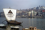 A series of images about port wine production in Portugal c 1960 - Ferreirinha Ferreira rabelo boat with oak barrels in city of Porto