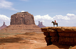 AZ, Monument Valley, Bruce, Native American Navajo Indian on horseback, bluff .Photo Copyright: Lee Foster, lee@fostertravel.com, www.fostertravel.com, (510) 549-2202.Image: azmonu202
