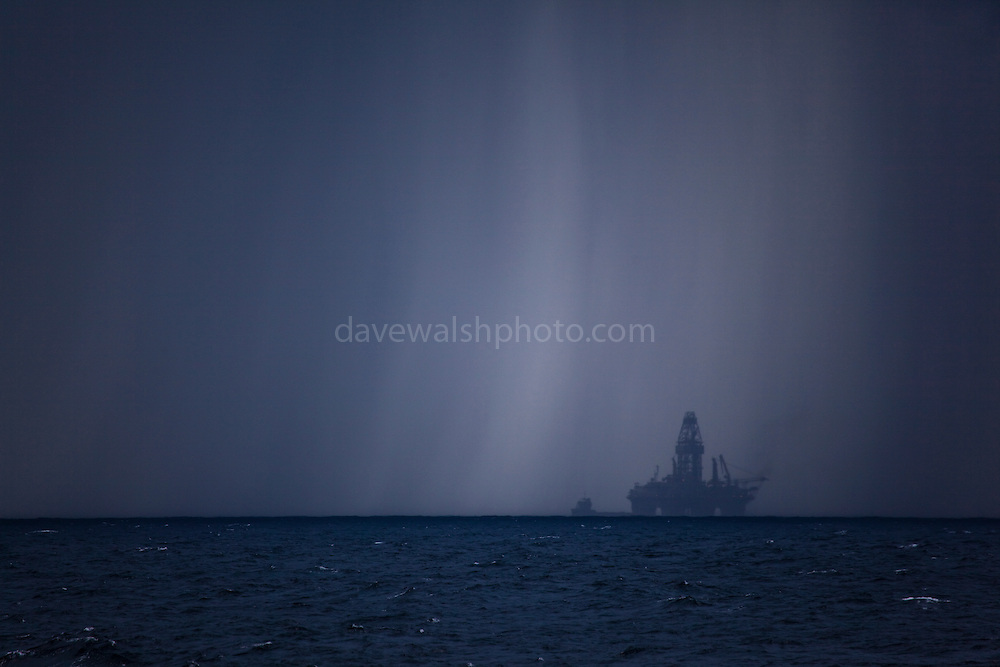 Transocean Development Driller rig in squall at Deepwater Horizon disaster Site. Photograph made on board the Greenpeace ship Arctic Sunrise, September 2010.