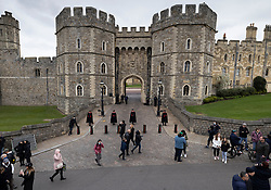 © Licensed to London News Pictures. 10/04/2021. Windsor, UK. Members of the public walk past Windsor Castle in Berkshire. The British Royal Family have announced the death of Prince Philip, The Duke of Edinburgh, at the age of 99. Photo credit: Peter Macdiarmid/LNP