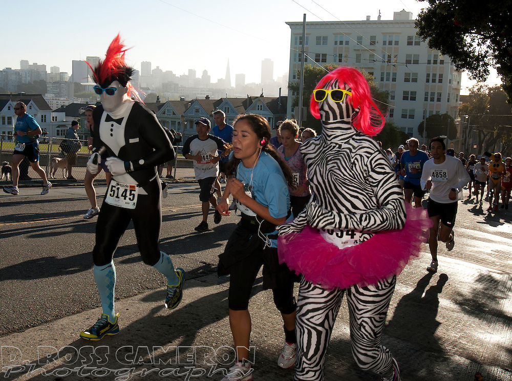 Costumed runners climb the Hayes Street hill during the 101st Bay to Breakers 12K footrace, Sunday, May 20, 2012 in San Francisco. More than 50,000 people participated in the 7.46-mile race, ranging from elite runners to those who ran in costume -- or nothing at all. (Photo by D. Ross Cameron)