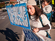 """07 DECEMBER 2010 - PHOENIX, AZ: MARIA MONTE ROSO and her son, ANDY PEREZ, 2, both from Phoenix, picket the front of US Sen. John McCain's office in Phoenix Tuesday. Dolores Huerta joined her at the picket. Huerta, who started working in the civil rights movement in the 1960's, threw her support behind students fasting on behalf of the DREAM Act in front of Sen. John McCain's office Tuesday. The student picked McCain's office because he used to support the DREAM Act. They hope that the US Senate will pass the DREAM Act during its """"lame duck"""" session. The Senate debated and defeated similar legislation just before the November general election.     PHOTO BY JACK KURTZ"""
