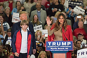 Melania Trump speaks to the crowd of supporters as Republican presidential candidate billionaire Donald Trump and son Barron look on during a campaign rally at the Myrtle Beach Convention Center November 24, 2015 in Myrtle Beach, South Carolina.