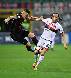 MILAN, March 19, 2017  AC Milan's Lucas Ocampos (L) competes with Genoa's Diego Laxalt during a Serie A soccer match between AC Milan and Genoa, in Milan, Italy, March 18, 2017. AC Milan won 1-0. (Credit Image: © Alberto Lingria/Xinhua via ZUMA Wire)