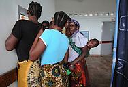 MWANZA, TANZANIA.  Tanzanian mothers que for morning porridge at Bugando Medical Center in Mwanza, Tanzania on Thursday, September 4, 2014.  © Chet Gordon for AmeriCares.