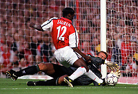 Liverpool goalkeeper SanderWesterveld saves at the feet of Arsenals Lauren. Arsenal 2:0 Liverpool, F.A.Carling Premiership, 21/8/2000. Credit : Colorsport / Andrew Cowie.