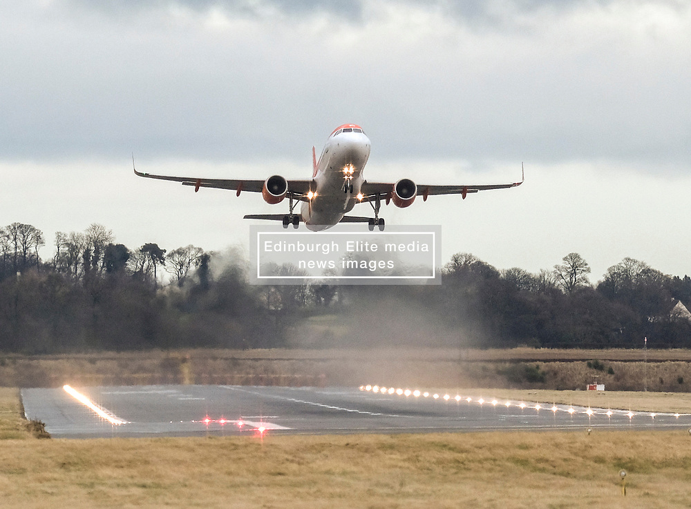 High Winds at Edinburgh Airport, Tuesday 7th January 2020<br /> <br /> Planes struggled on landing and take-off as high winds hit Edinburgh Airport today<br /> <br /> Pictured: A Easyjet flight takes off<br /> <br /> Alex Todd   Edinburgh Elite media