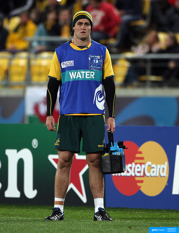Australian captain James Horwill, who was rested for the match, acts as the teams water boy during the Australia V USA, Pool C match during the IRB Rugby World Cup tournament. Wellington Stadium, Wellington, New Zealand, 23rd September 2011. Photo Tim Clayton...