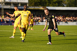 Port Vale's Tom Conlon (right) celebrates after scoring his sides third goal of the game during the Sky Bet League Two match at Borough Sports Ground, Sutton. Picture date: Saturday October 9, 2021.