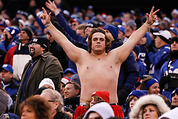 A shirtless New York Giants fan in the stands during the NFL Game between the Philadelphia Eagles and the New York Giants.  The Eagles won 38-31 at The New Meadowlands Stadium in East Rutherford, New Jersey on Sunday December 19th 2010. (Photo By Brian Garfinkel)