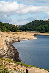 The effects of the heatwave of current heatwave can be clearly seen in the Depleted water levels at Derwent Reservoir in the Peak national park. <br /> Derwent was on of the dams used by the Legendary 617 Squadron (Dambusters) for training before operation Chastise the attack on German dams carried out 16–17 May 1943 and appears in the Original Dambusters Film<br /> <br /> 08 August 2018<br /> Copyright Paul David Drabble<br /> www.pauldaviddrabble.co.uk