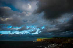 © Licensed to London News Pictures. 18/03/2014<br /> <br /> Saltburn, England <br /> <br /> The furthest edge of Huntcliff in Saltburn by the Sea catches some of the final rays of the sun before it sets.<br /> <br /> Photo credit : Ian Forsyth/LNP