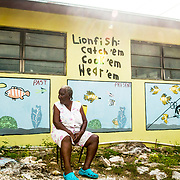 A mural is painted on the side of a small grocery store on Eleuthera Island, Bahamas depicting how the fait of the Bahamian fishery is tied closely to that of the invasive lionfish (Pterois volitans). An island elder looks to the past as a healthy fishery becomes embattled.