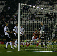 Photo: Steve Bond.<br />Derby County v Blackpool. Carling Cup. 28/08/2007. Kaspars Gorkss (C) turns as his header hits the back of the net
