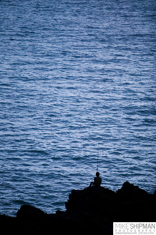 South America, Uruguay, Maldonado, Punta Ballena, young fisherman, pescadero