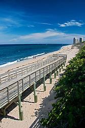boardwalk to beach, John D. MacArthur Beach State Park, high-rise condominiums and hotels on Singer Island in distance, North Palm Beach, Florida, Atlantic Ocean