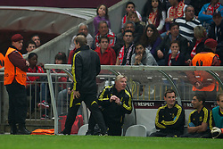 BRAGA, PORTUGAL, Thursday, March 10, 2011: Liverpool's manager Kenny Dalglish pulls his hamstring after chasing for a ball during the UEFA Europa League Round of 16 1st leg match against Sporting Clube de Braga at the Estadio Municipal de Braga. (Photo by David Rawcliffe/Propaganda)