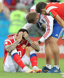 SOCHI, July 7, 2018  Fedor Smolov (L) of Russia sits on the pitch after missing a penalty kick during the penalty shootout of the 2018 FIFA World Cup quarter-final match between Russia and Croatia in Sochi, Russia, July 7, 2018. Croatia won 6-5 (4-3 in penalty shootout) and advanced to the semi-finals. (Credit Image: © Yang Lei/Xinhua via ZUMA Wire)