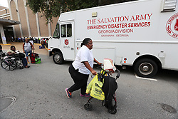 Gloria Daniels, 70, arrives using her walker from her home to join hundreds of local residents being evacuated from the city at the Savannah Civic Center during a mandatory evacuation for Hurricane Irma on Saturday, September 9, 2017, in Savannah, Ga. Officials are expecting 1,500 to 3,000 without transportation to leave by buses that are being provided. Photo by Curtis Compton/Atlanta Journal-Constitution/TNS/ABACAPRESS.COM