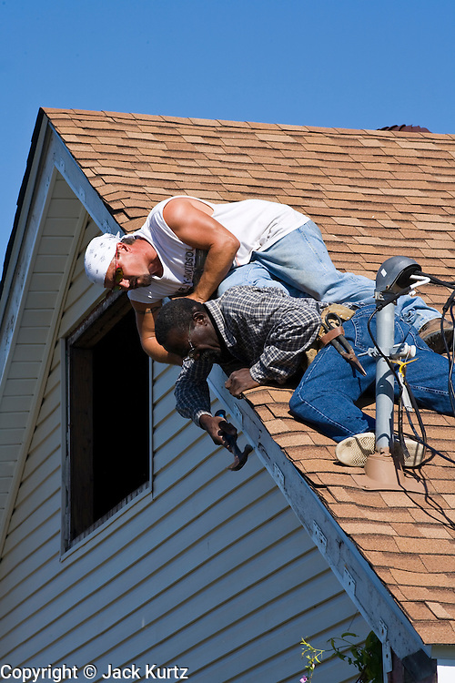 20 SEPTEMBER 2006 - NEW ORLEANS, LOUISIANA: Workers rebuild the facing of a home in the Lower 9th Ward of New Orleans, LA. The neighborhood was abandoned after flooding from nearby canals after Hurricane Katrina inundated this part of the city.  Photo by Jack Kurtz / ZUMA Press