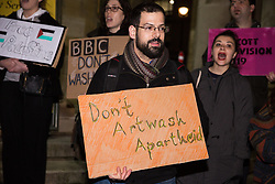 London, UK. 8th February, 2019. Eran Cohen, Israeli-born member of Jewdas, joins pro-Palestinian activists attending a 'Love Eurovision, Hate Apartheid!' protest outside BBC Broadcasting House organised by London Palestine Action to call on the BBC to withdraw from the 2019 Eurovision Song Contest hosted by Israel so as to avoid complicity in 'artwashing' Israel's violations of Palestinian human rights. The protest formed part of a global campaign to Boycott Eurovision in Israel.