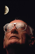 """Sir Arthur C. Clarke, composite. Colombo, Sri Lanka. Sir Arthur C. Clarke gazes at the moon. """"I can never look now at the Milky Way without wondering from which of those banked clouds of stars the emissaries are coming,"""" one of Arthur C. Clarke's characters says in the short story """"The Sentinel"""" (1948), which was the basis for his book 2001 - A Space Odyssey. MODEL RELEASED"""