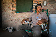 2014/11/23 – Quimili, Argentina: Raúl Eduardo Leal (56) in his house  with his dog during siesta time at the Guaycurú Indigenous Community of Bajo Hondo. He complains how the soya producers are deforestation the area around his community. The region around Quimili on the Santiago Estero Province is being vastly converted from forestland into fields to produce soy, detroying the habitats for local species and indigenous people. (Eduardo Leal)