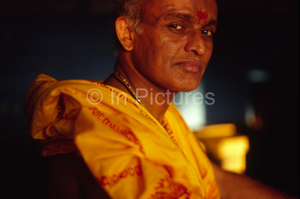 Professor Balasubramanian, a senior teacher and accomplished Kathakali performer at the Kerala Kalamandalam.The Kalamandalam was founded in the 1930's to preserve the ancient forms of Keralan arts and dance of which Kathikali, a mute mixture of ballet and drama is the most well known..Cherathuruty, Kerala, India