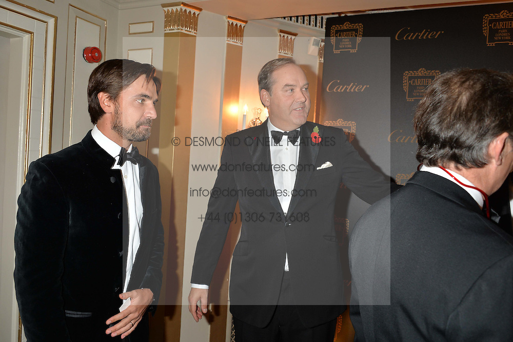 Left to right, HENRY ST.GEORGE, the HON.HARRY HERBERT and LAURENT FENIOU at the 26th Cartier Racing Awards held at The Dorchester, Park Lane, London on 8th November 2016.