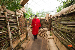 © Licensed to London News Pictures. 19/05/2014. London, England. Chelsea Pensioner Ray explores the WWI trench in the Birmingham City Council Garden.  Press Day at the RHS Chelsea Flower Show. On Tuesday, 20 May 2014 the flower show will open its doors to the public.  Photo credit: Bettina Strenske/LNP