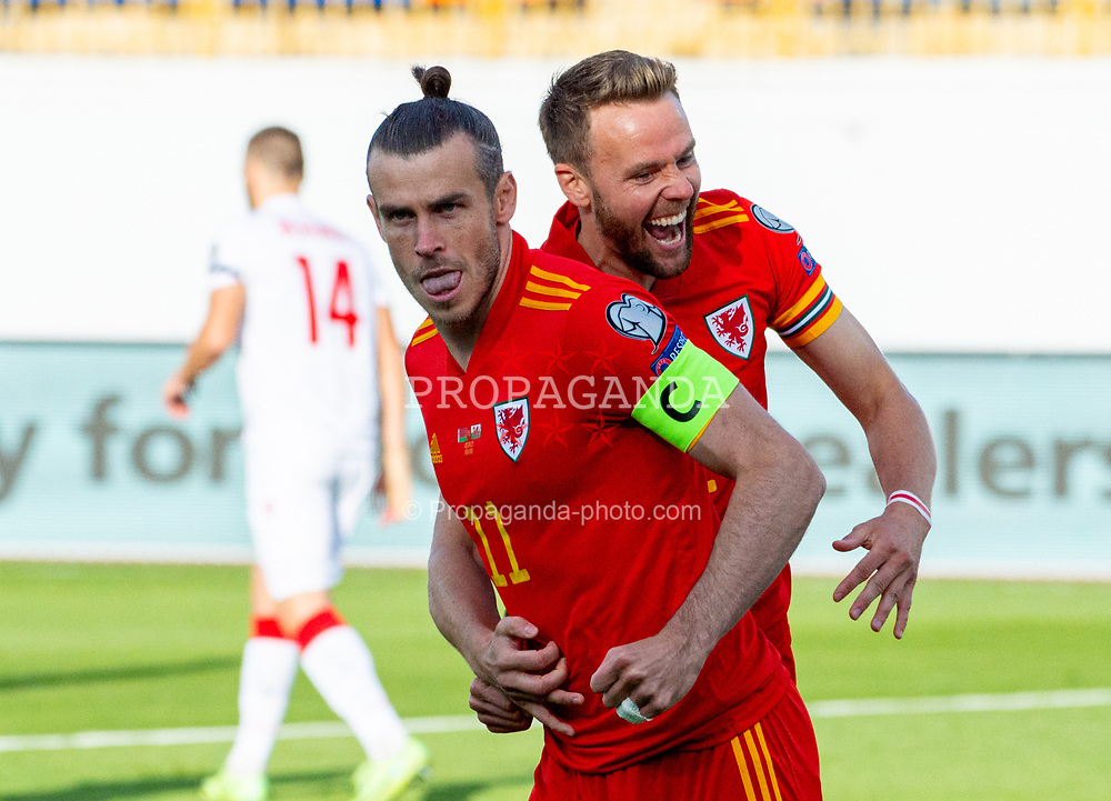 KAZAN, RUSSIA - Sunday, September 5, 2021: Wales' captain Gareth Bale (L) celebrates with team-mate Chris Gunter after scoring the first goal from a penalty kick during the FIFA World Cup Qatar 2022 Qualifying Group E match between Belarus and Wales at the Central Stadium. Wales won 3-2. (Pic by Dinar Fatykhov/Propaganda)