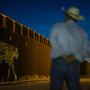 An image of a jaguar is projected on the border wall, May 12, 2017, in Douglas, Arizona. Eco-political artist Lauren Strohacker used camera trap photographs from the Northern Jaguar Reserve for her, Un-fragmenting/Des-Fragmentando event.