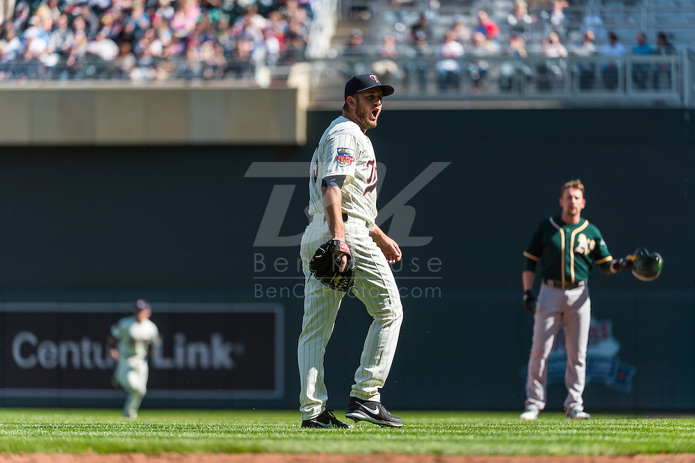 Glen Perkins #15 of the Minnesota Twins yells after striking out Josh Donaldson #20 of the Oakland Athletics (not shown) on April 9, 2014 at Target Field in Minneapolis, Minnesota.  The Athletics defeated the Twins 7 to 4.  Photo by Ben Krause