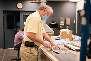 OPS employees make masks at the Phalen Clinic n Saint Paul, Minnesota on Wednesday, April 29, 2020.