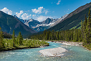 The Rockwall rises above the Kootenay River, seen from the Paint Pots hikers' bridge in Kootenay National Park, British Columbia, Canada.