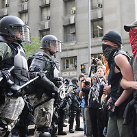 """Members of the police and demonstrators from  """"The People's March to the G20"""" face off before continuing their march through the streets of downtown Pittsburgh, Pennsylvania on September 25, 2009.   Pittsburgh is the host city for the two day  G20 Summit of world leaders.     UPI /Archie Carpenter"""