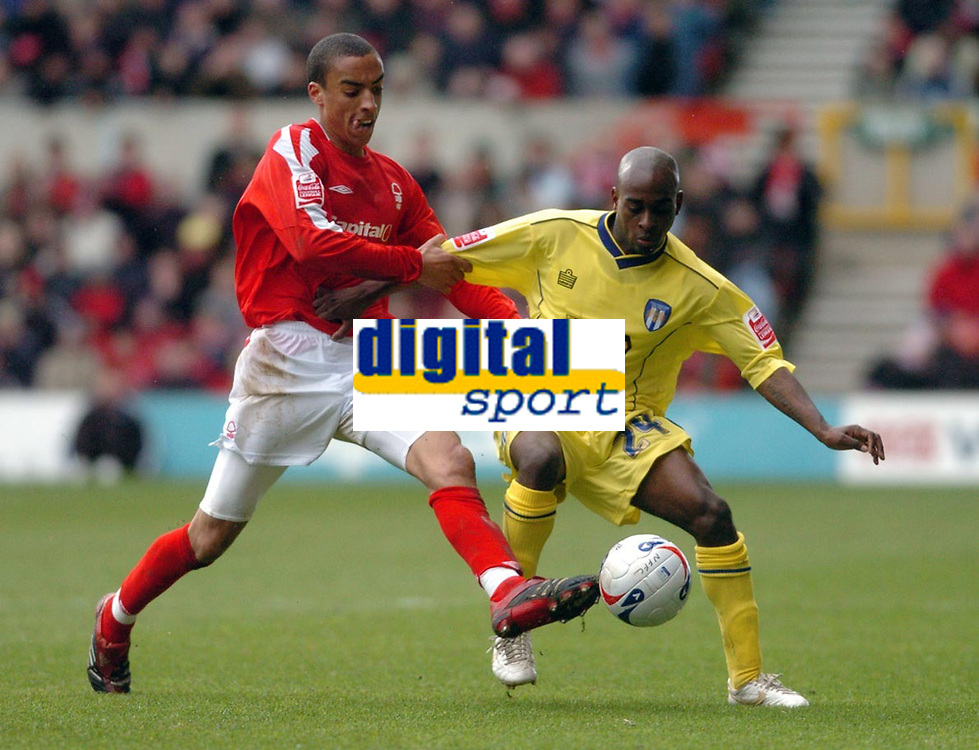 Photo: Leigh Quinnell.<br /> Nottingham Forest v Colchester United. Coca Cola League 1. 08/04/2006. Forests James Perch grabs hold of Colchesters  Jamal Campbell-Ryce.
