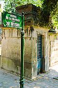 Mausoleum and sign at Père Lachaise Cemetery, Paris, France