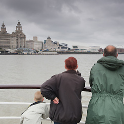People riding the ferry towards the Museum of Liverpool