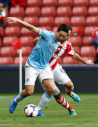 Manchester City's Samir Nasri holds off Stoke City's Marc Wilson - Photo mandatory by-line: Matt Bunn/JMP - Tel: Mobile: 07966 386802 14/09/2013 - SPORT - FOOTBALL -  Britannia Stadium - Stoke-On-Trent - Stoke City V Manchester City - Barclays Premier League