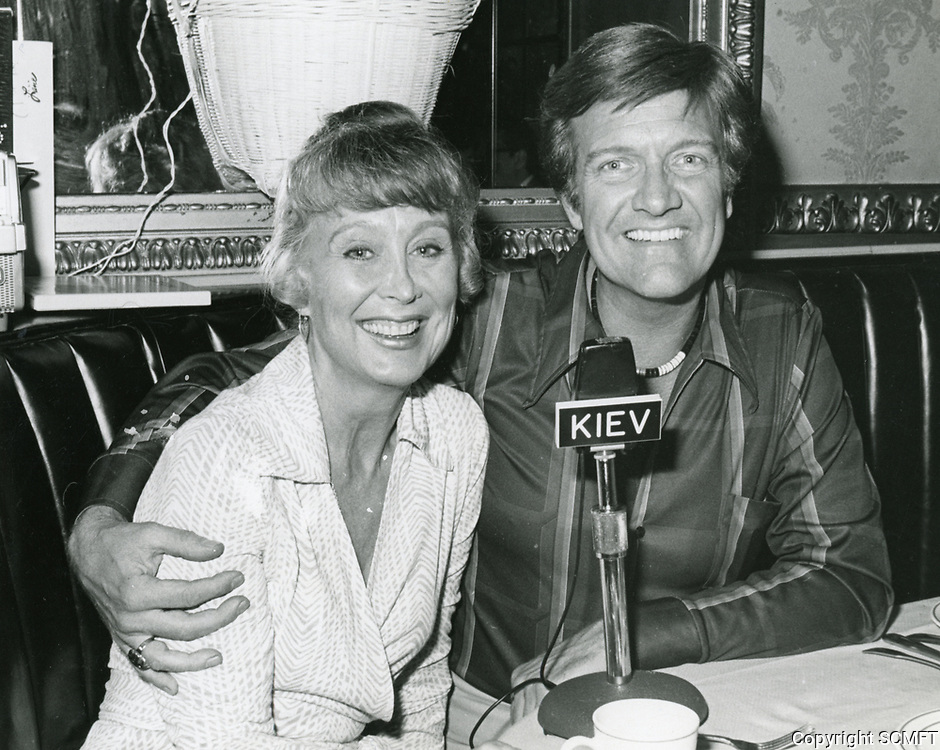 1978 Radio commentator/interviewer, Gregg Hunter is seen interviewing Betty Garrett during his KIEV radio show at the Hollywood Brown Derby Restaurant, on Vine St.