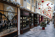 Four days before Christmas, retailers in Burlington Arcade remain closed after the governments last-minute u-turn on the easing of Coronavirus pandemic rules. London and the South-East has been put under a Tier 4 restriction, forcing the closure of non-essential shops and small businesses, on 21st December 2020, in London, England.