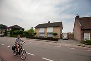 Fietsers rijden door het dorpje Budel-Schoot.<br /> <br /> Cyclists ride in the village Budel-Schoot.