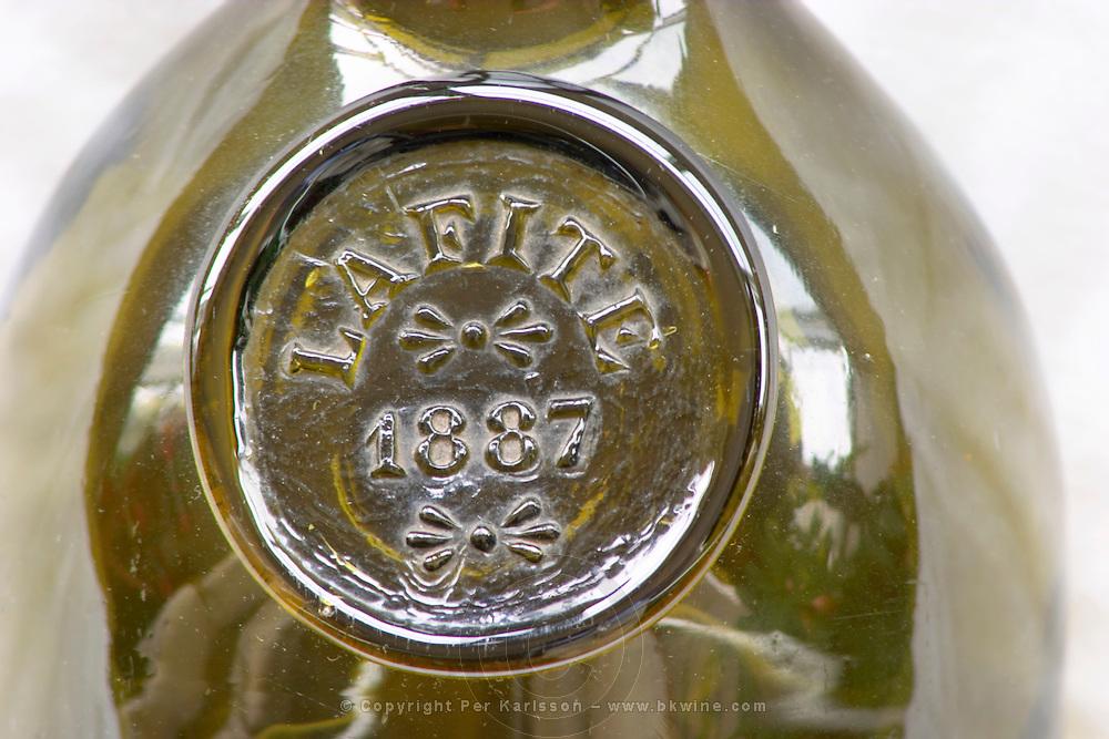 An antique wine bottle chateau lafite lafitte 1887, Pauillac, Bordeaux, France with a seal blazon
