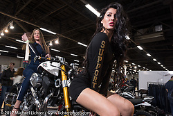 Models with a Confederate Motorcycle on display in the Custom and Tuning Show, the custom bike show portion of the big Motor Spring bike show in Moscow, Russia. Sunday April 23, 2017. Photography ©2017 Michael Lichter.
